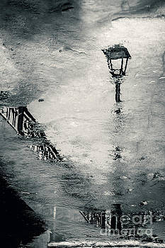 Dimitar Hristov - Street lamps and wet pavement at evening