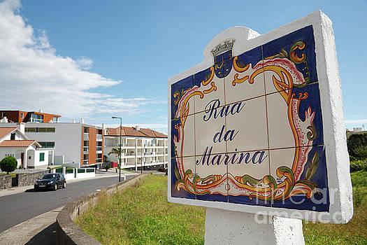 Street name sign by Gaspar Avila