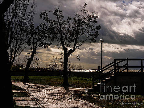 Strolling the waterfront on a stormy day by Giovanni Bertagna