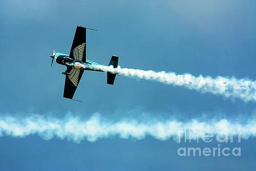 Simon Bratt Photography LRPS - Stunt plane with smoke trails