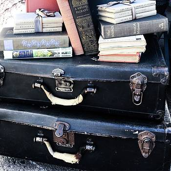 Suitcases and Books by Jen Lynn Arnold