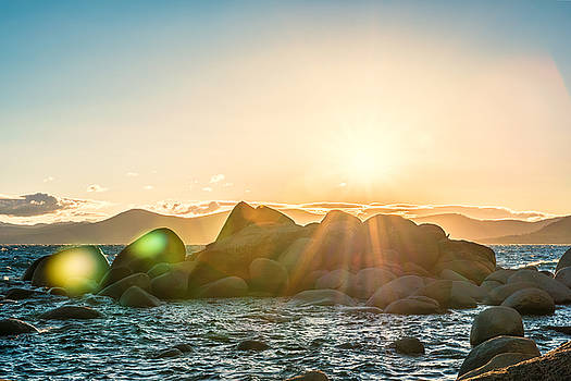 Summer Sunset Over Rocks on Lake Tahoe East Shore near Bonsai Rock with Lens Flare and Mountains by Brian Ball