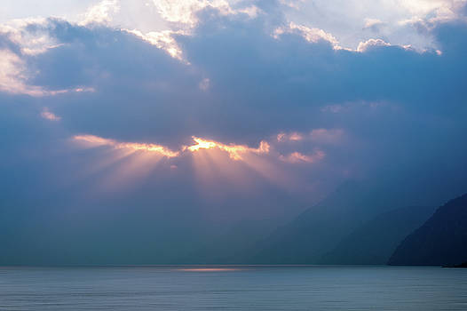 Sun beams at Sunset on Lake Atitlan, Guatemala by Daniela Constantinescu