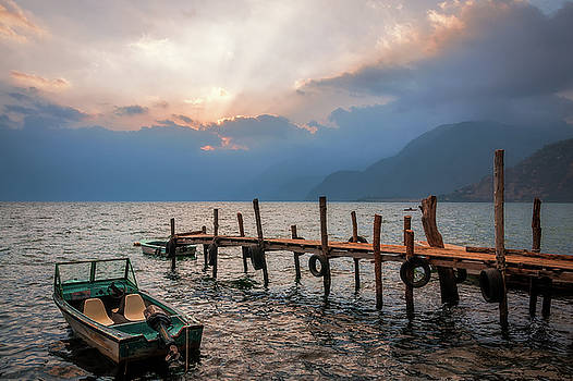 Sun beams at Sunset on Lake Atitlan, Guatemala -View from the docks by Daniela Constantinescu