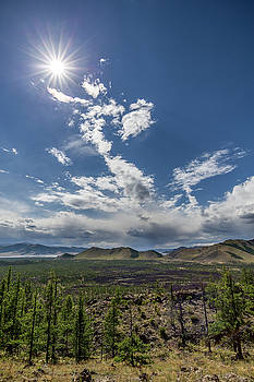 Sun over volcanic landscape by Hitendra SINKAR