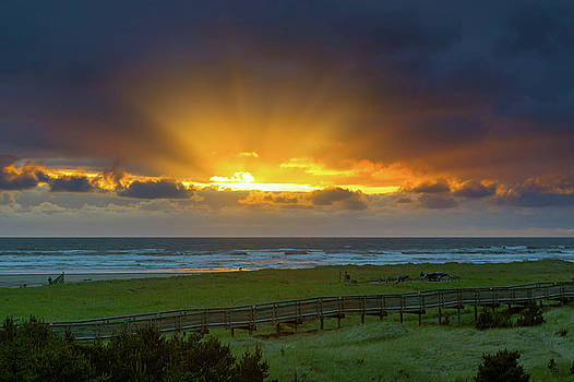 Sun Rays at Long Beach Washington during Sunset by David Gn