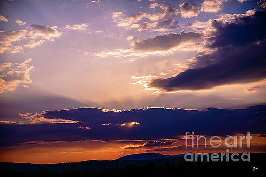 Sun Rays Over Saddle Back Mt by Alana Ranney