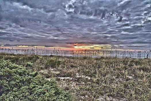 Sun rise on the beach by Bill Hosford