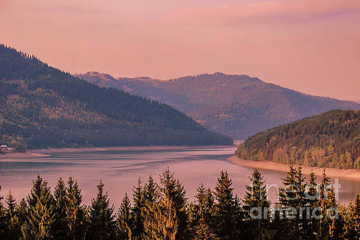Sun sets over the mountains by Claudia M Photography