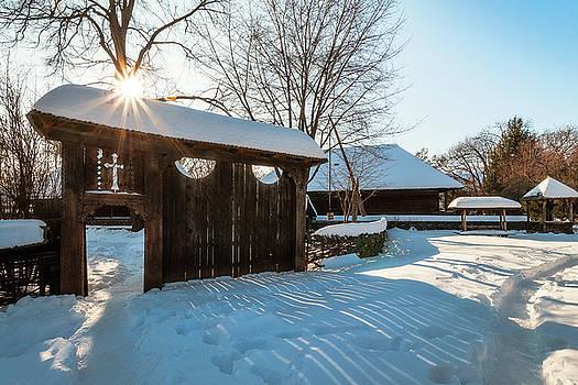 Sun star in a Romanian Village in winter by Daniela Constantinescu