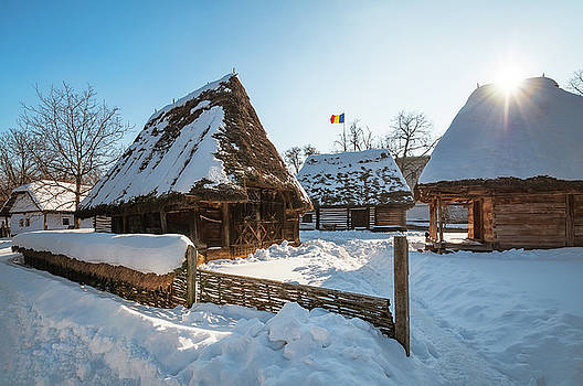 Sun warming up a traditional Romanian homestead in winter by Daniela Constantinescu