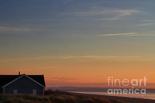 Sundown at the beach by John Edwards