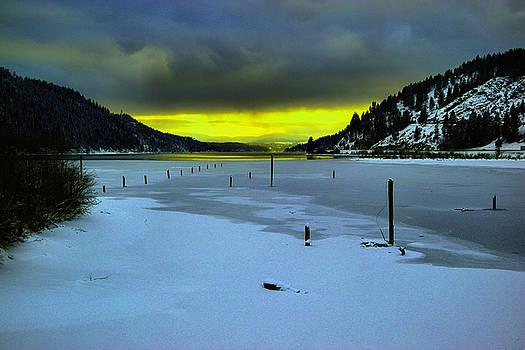 Sundown on lake shore by Jeff Swan