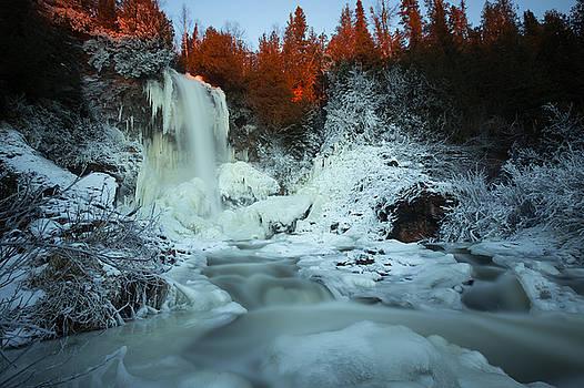 Sunlit edge of the Moraine Falls by Jakub Sisak