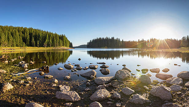 Sunny landscape of a mountain lake by Evgeni Dinev