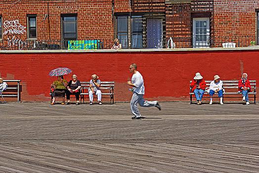 Sunny morning on a boardwalk in Brighton Beach  by Zalman Latzkovich