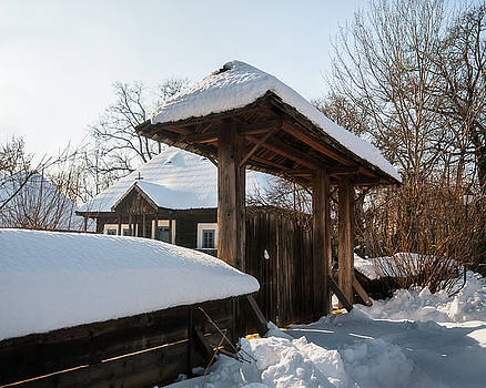 Sunny Winter Day at an old Romanian Homestead with a wooden Gate by Daniela Constantinescu