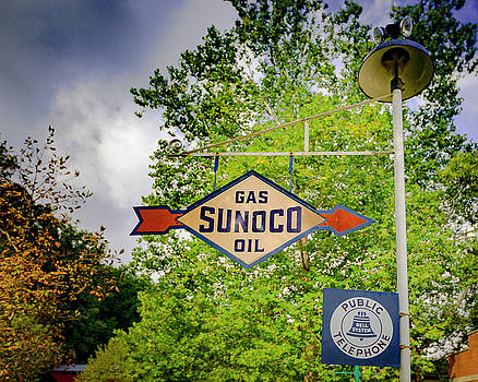 Sunoco Sign on Pole with Public telephone by Jack R Perry