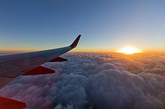 Sunrise Above the Clouds on Southwest Airlines by Dustin K Ryan