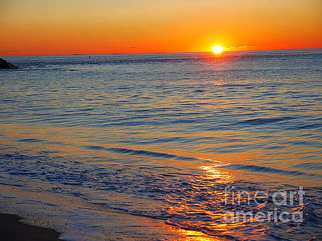 Sunrise across the ocean by Nancie DeMellia