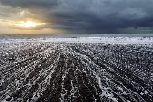 Sunrise along the Iceland coast by Dana Plourde