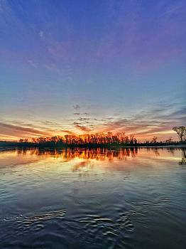 sunrise and Missouri river by Dustin Soph
