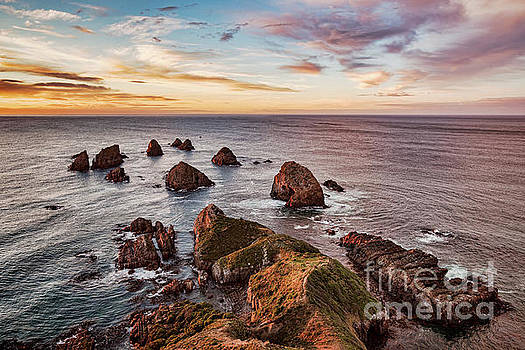 Sunrise at Nugget Point by Colin and Linda McKie