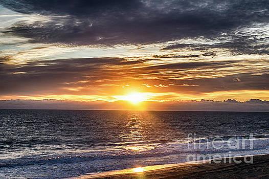 Sunrise at the beach by Carol Bilodeau