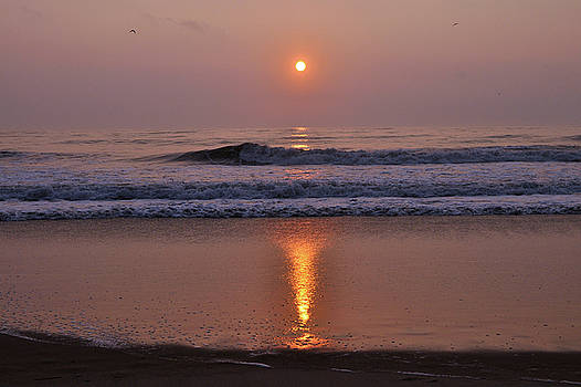 Sunrise at the beach by Jana Goode
