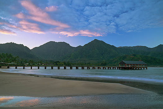 Sunrise in paradise over Hanalei Bay. by Larry Geddis