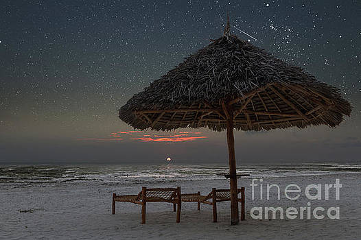 Sunrise in tropical beach of Zanzibar with starry sky by Pier Giorgio Mariani