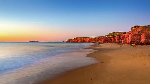 Sunrise on the beach by Yves Keroack