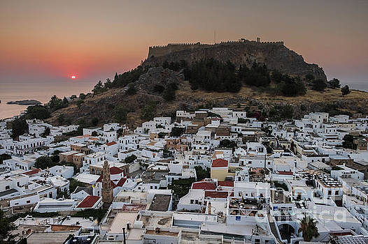 Sunrise over Lindos town, Rhodes, Greece by Martin Williams