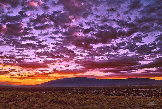 Sunrise over Sandia Mountains by Richard Estrada