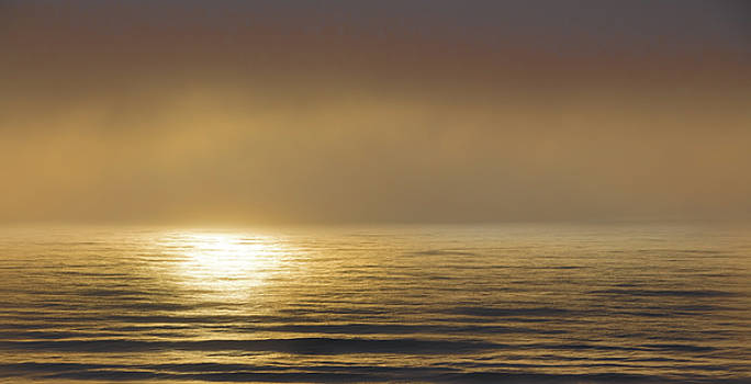 Sunrise Reflected Under a Morning Fog by Richard Goldman