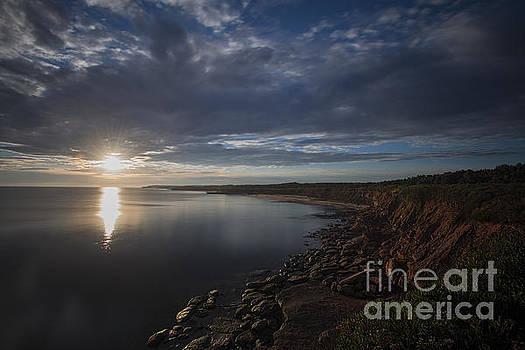 Dan Friend - Sunrise the red cliffs on Prince Edward Island