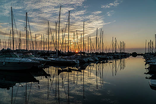 sunrise though the masts of Chicago sail boats by Sven Brogren