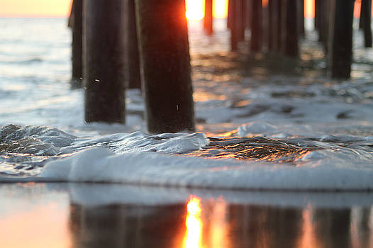 Sunrise Thru The Pier by Robert Banach