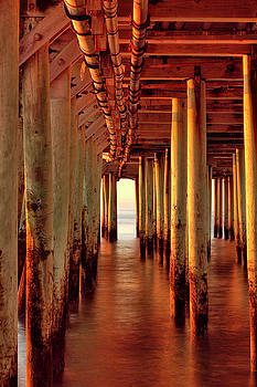 Sunrise under the pier by Brian Pflanz