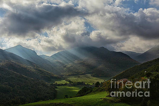 Sun's rays light up the valley by Luigi Morbidelli