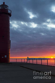 Sunset accompanied by Muskegon Lighthouse by Amie Lucas