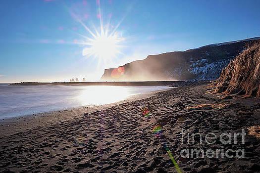 Sunset At Black Sand Beach by Benjamin Wiedmann