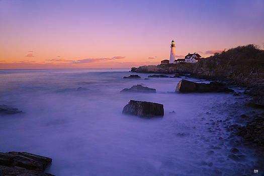 Sunset at Portland Head Light by John Meader