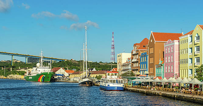 Sunset at Punda with boats in the sun -  Views around Curacao by Gail Johnson