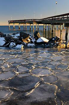 Reimar Gaertner - Sunset at Toronto Center Island Pier in winter with ice flows an