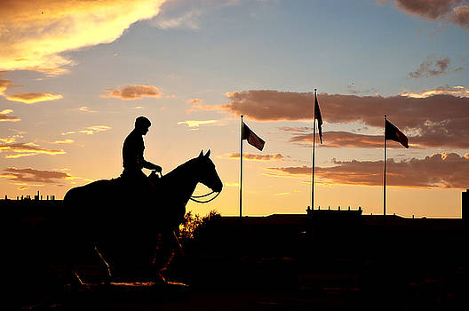 Sunset Behind Will Rogers and Soapsuds Statue at Texas Tech University in Lubbock by Ilker Goksen