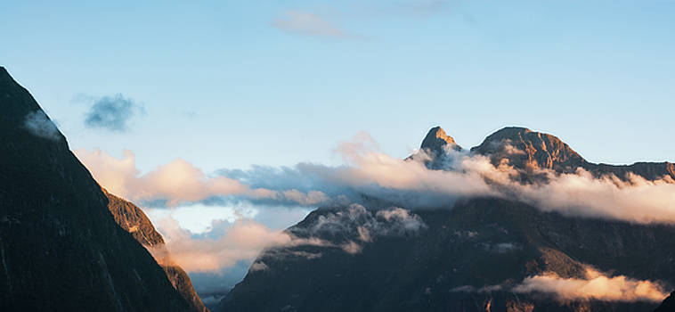 Sunset Clouds and the Sheer Cliffs at Milford Sound in New Zeala by Daniela Constantinescu
