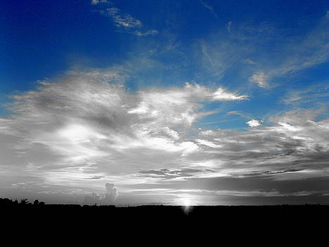 Sunset in Black White and Blue by Julie Pappas