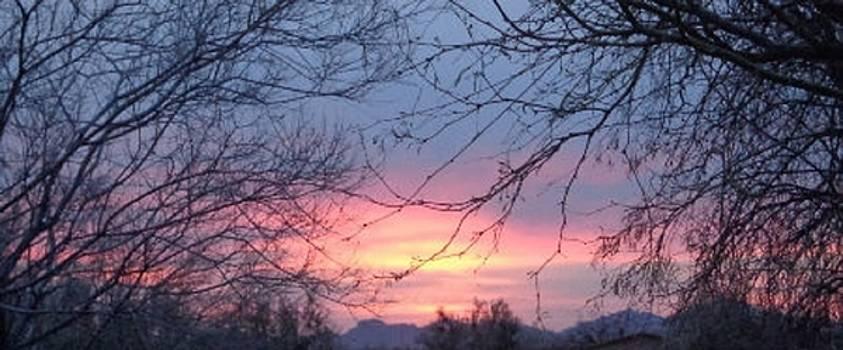 Sunset in Picture Rocks by Mozelle Beigel Martin