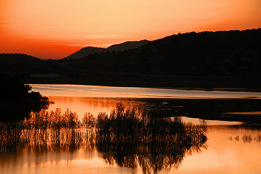Sunset in the Andalusian Guadalquivir River by Begonia Mallenco